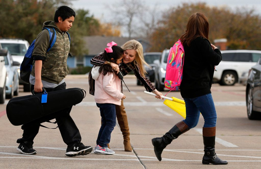 Second-grader Carla Puente, 7, gets a hug from principal Aimee Lewis at McKenzie Elementary School in Mesquite on Tuesday, Dec. 5, 2017. Lewis has been a principal in the Mesquite school district for the past 16 years.