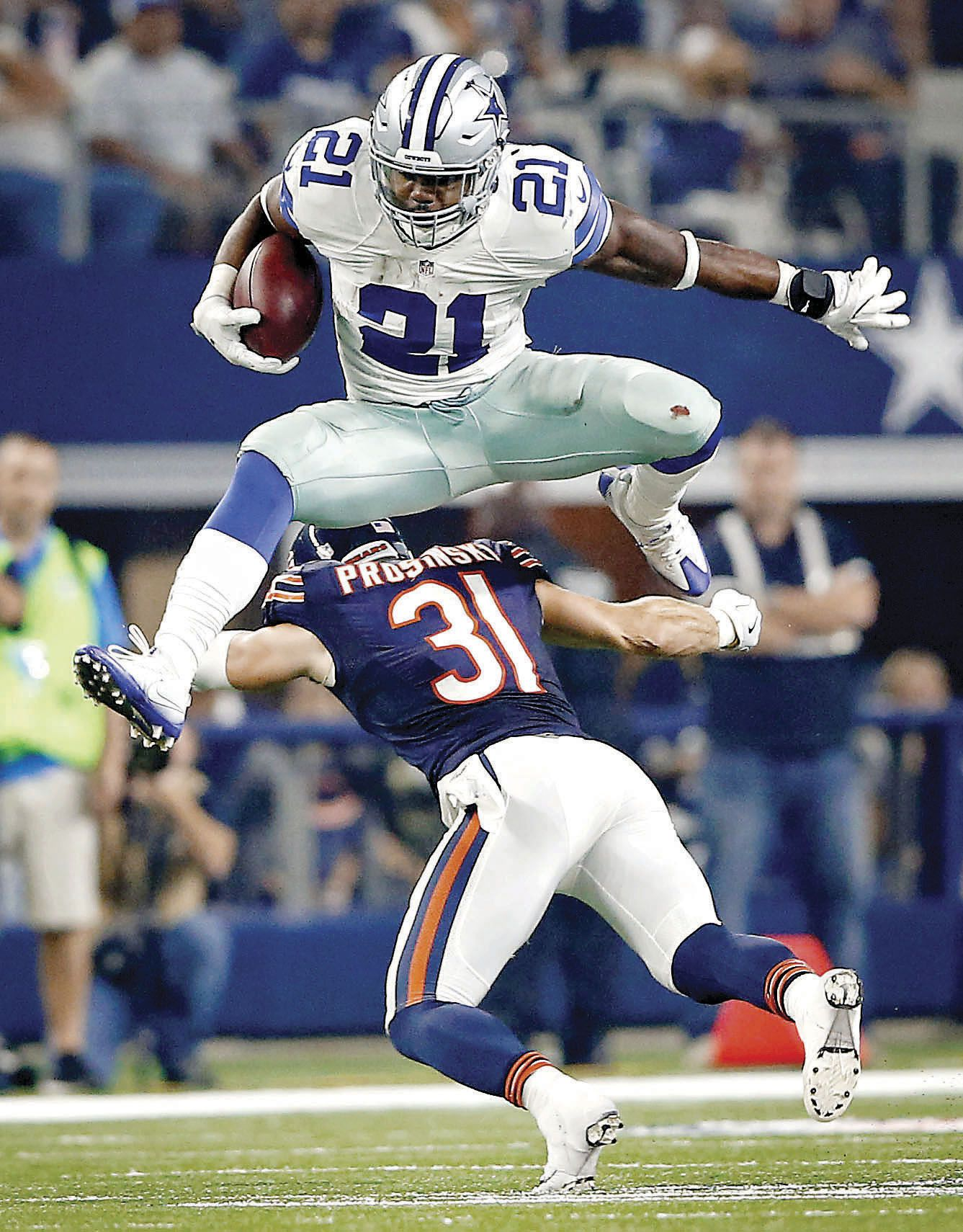 Dallas Cowboys rookie running back Ezekiel Elliott leaped over Chicago Bears safety Chris Prosinski on a run play at AT&T Stadium in Arlington on Sept. 25.