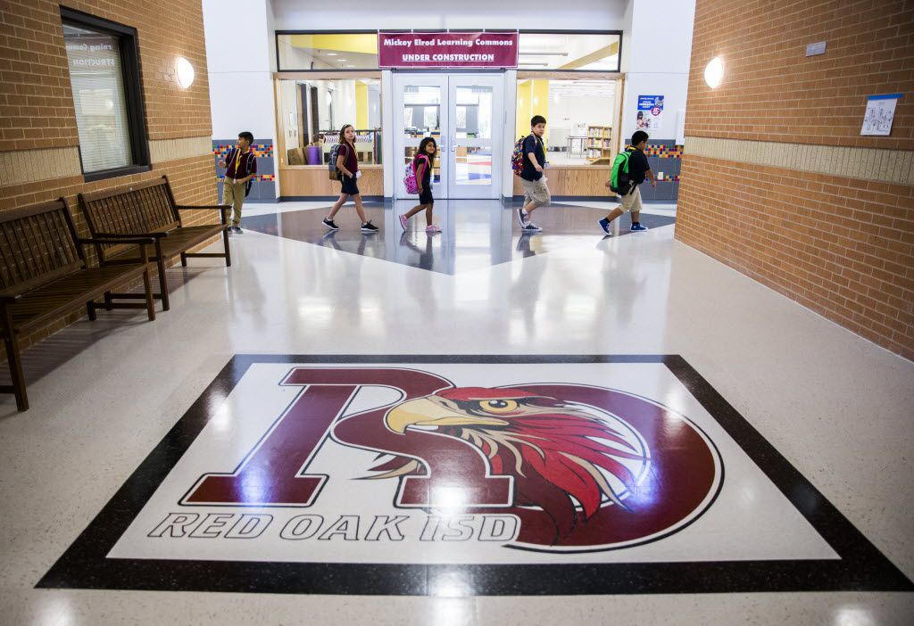 Students walk through the hallway on Wednesday at Donald T. Shields Elementary in Glenn Heights. The school reopened its doors this week after it was heavily damaged in a tornado eight months ago.