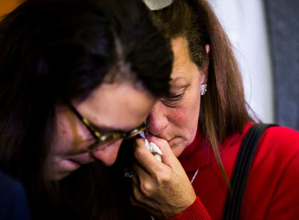 Bonnie Jameson (right), mother of Kendra Hatcher, and daughter Melissa Jameson hug in the hallway after Kristopher Love was sentenced to death for killing Hatcher.