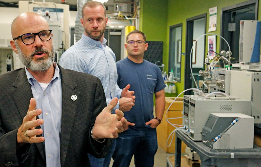 University of North Texas chemistry professor Guido Verbeck (left) talks about a breathalyzer that will test for drugs, as Tim Wing, InspectIR co-founder/managing director (center) and UNT graduate student Tom Kiselak (right) listen.