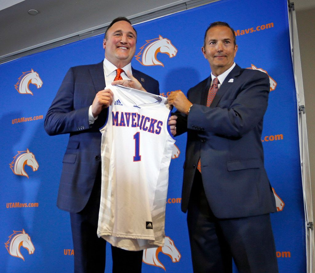 Texas-Arlington new NCAA college basketball head coach Chris Ogden, left, and athletic director Jim Baker pose during an introductory press conference in Arlington, Texas, Friday, April 6, 2018. (Paul Moseley/Star-Telegram via AP)