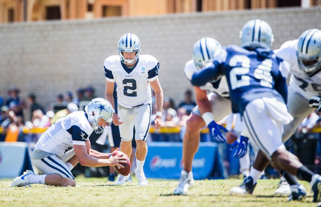 Dallas Cowboys kicker Brett Maher (2) kicks a field goal with help from punter Chris Jones (6) during a morning practice at training camp in Oxnard, California on Thursday, August 8, 2019. (Ashley Landis/The Dallas Morning News)