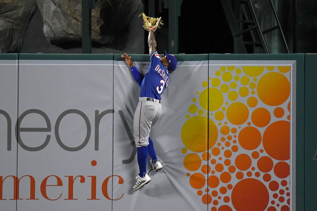 Texas Rangers center fielder Delino DeShields makes the catch on a ball hit by Los Angeles Angels' Brian Goodwin during the third inning of a baseball game Wednesday, Aug. 28, 2019, in Anaheim, Calif. (AP Photo/Mark J. Terrill)