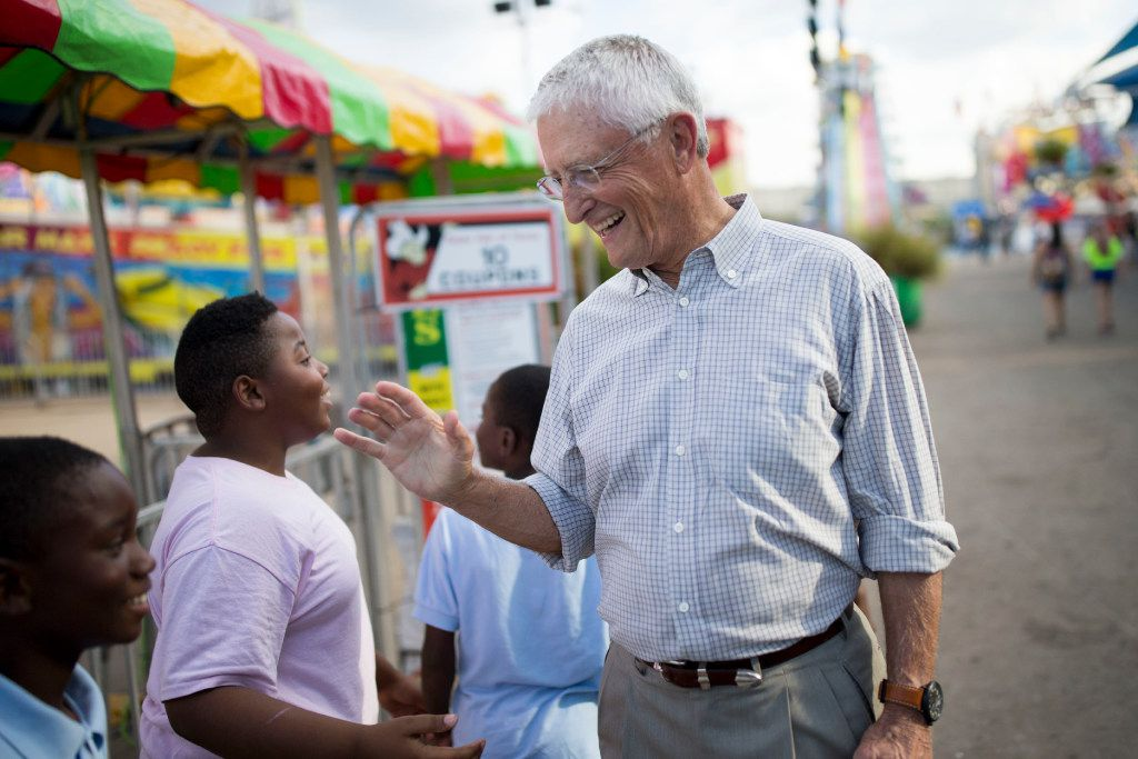 Don Williams, founder of non-profit corporation Foundation for Community Empowerment, interacts with students from Paul L Dunbar Elementary School during the State Fair of Texas at Fair Park on Oct. 19, 2016 in Dallas.