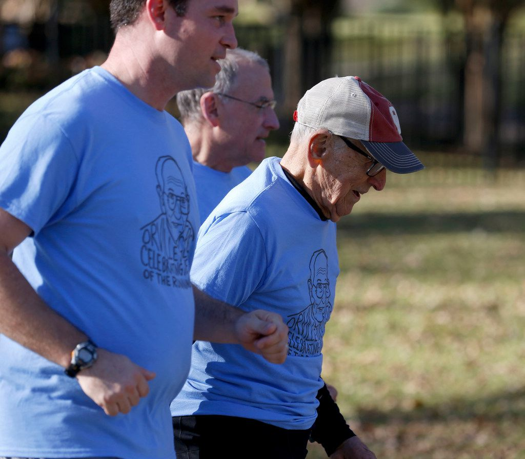 Orville Rogers, who is turning 100-years-old, runs with his family including his grandson-in-law Neal Anthony (front) and son Rick Rogers (back) near White Rock Lake in Dallas on Saturday, Nov. 25. Orville's family members ran a collective 100 miles that morning and finished the last mile with Orville. (Rose Baca/The Dallas Morning News)