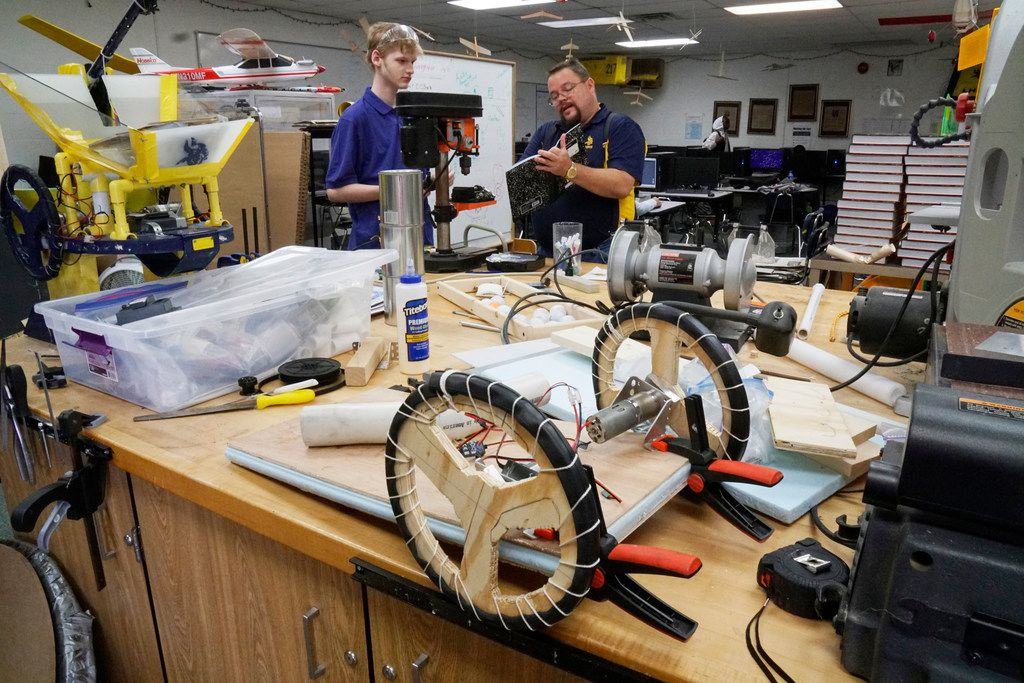 Lamar High robotics team member Aidan Cooper discusses design with his instructor, Erik Walla, after school. The team will be building a robot that can assist in firefighting.