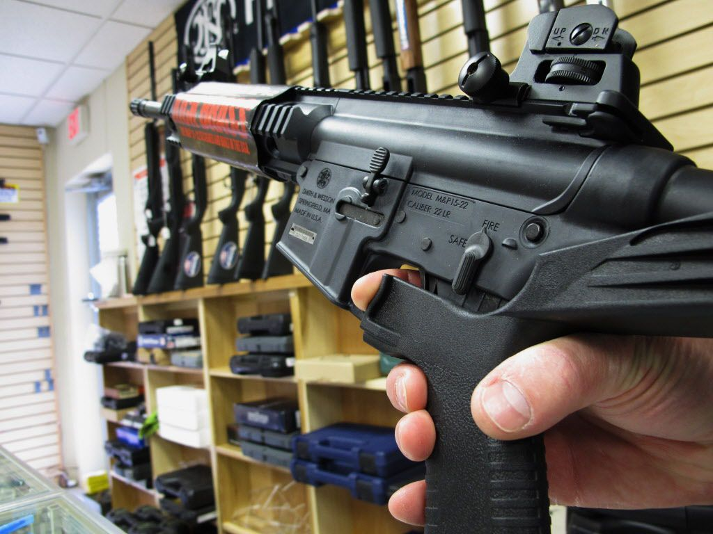 "An employee of North Raleigh Guns demonstrates how a ""bump stock"" works at the Raleigh, N.C., shop. The gunman who unleashed hundreds of rounds of gunfire on a crowd of concertgoers in Las Vegas attached a bump stock to at least one of his weapons, in effect converting semiautomatic firearms into fully automatic ones. (Allen Breed/The Associated Press)"