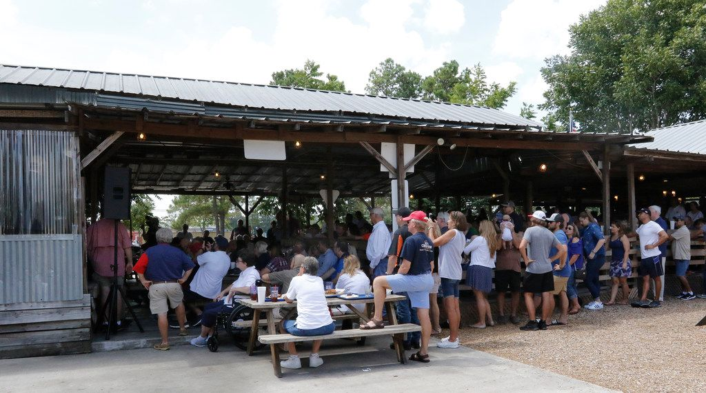 Voters listen to Sen. Ted Cruz talk during a retail stop at Tin Roof BBQ in Humble Texas, on Saturday, September 8, 2018. Ted Cruz campaigned in Humble, Texas, Texas on Saturday, while Beto O'Rourke campaigned a few miles away in Houston,