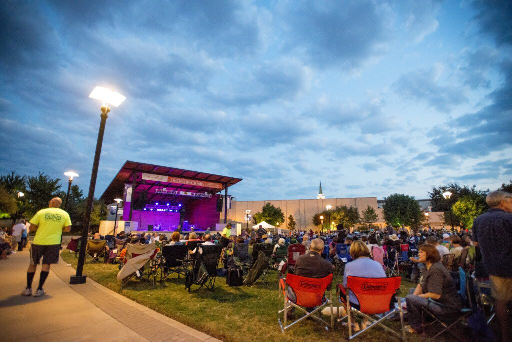 Concert-goers await the first act at the Everything Energy 2014 Free Concert at Levitt Pavilion in Arlington, Texas on September 26, 2014. Musicians Daphne Willis and headliner, Ruthie Foster performed for the large crowd.