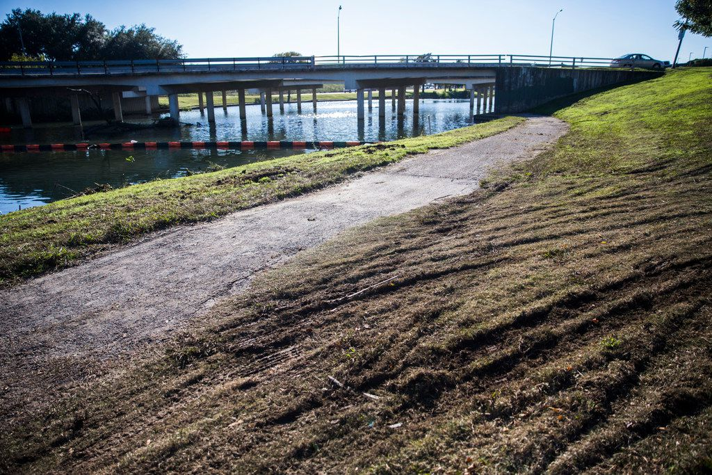 A trial winds under Lemmon Avenue at Bachman Lake Greenbelt at the corner of Lemmon Avenue and Northwest Highway on Wednesday.