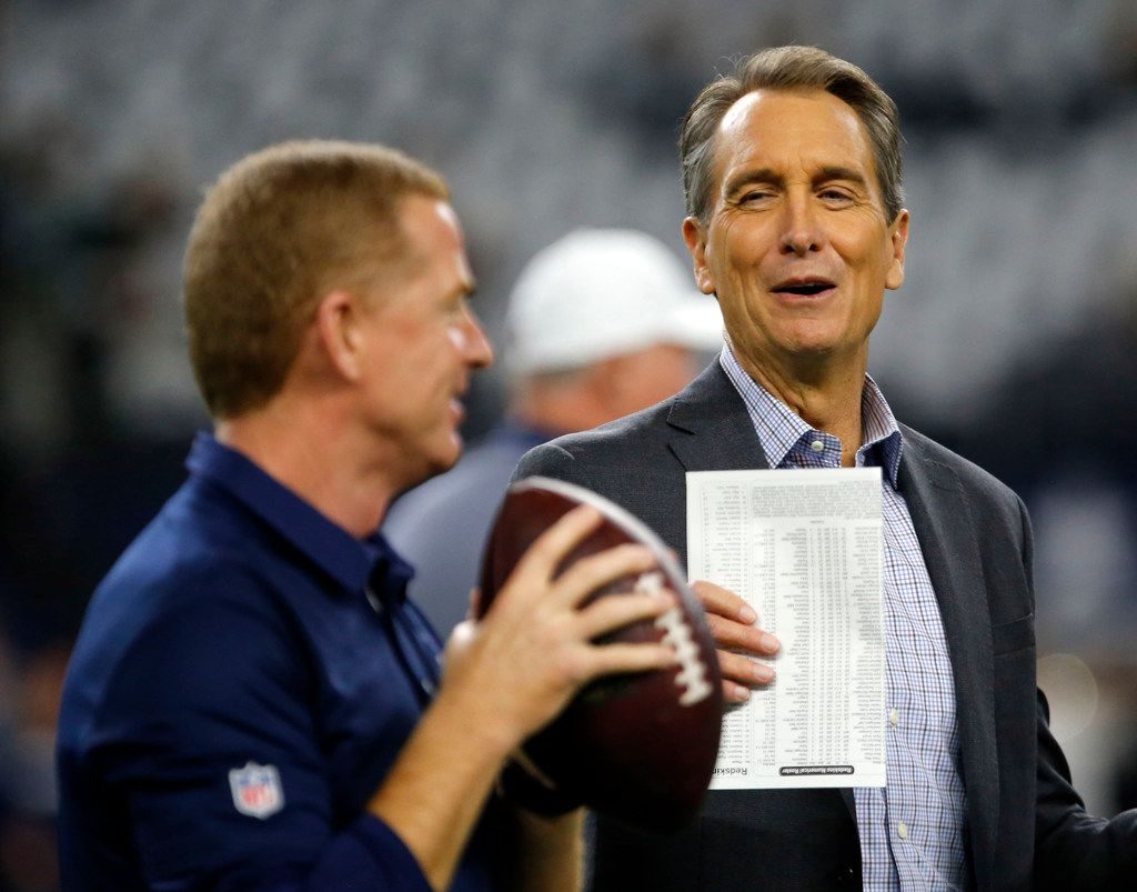 Broadcaster Cris Collinsworth jokes with Dallas Cowboys coach Jason Garrett before the start of a game between the Washington Redskins and Cowboys at AT&T Stadium in Arlington on Thursday, Nov. 30, 2017.