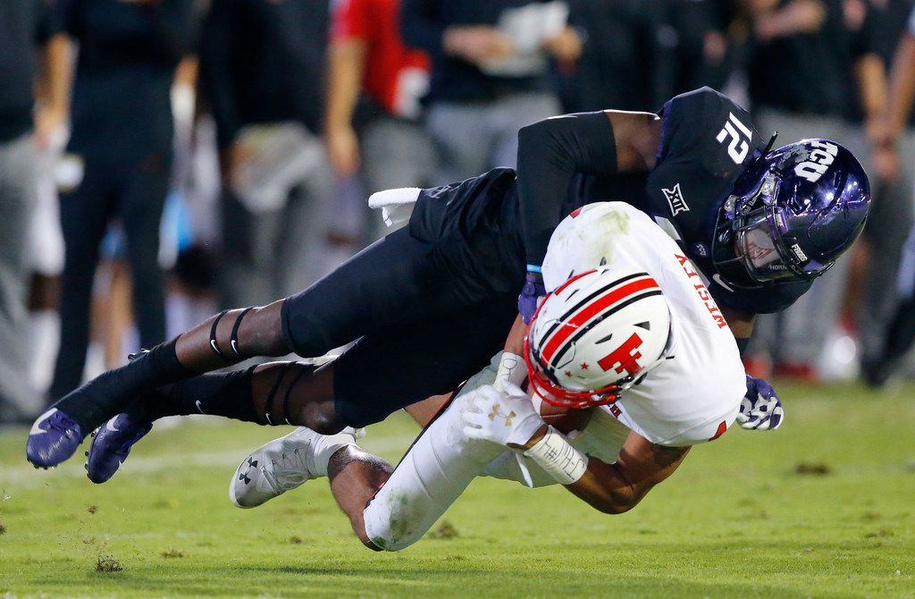 TCU Horned Frogs cornerback Jeff Gladney (12) makes an open field tackle of Texas Tech Red Raiders wide receiver Antoine Wesley (4) after a third quarter completion at Amon G. Carter Stadium in Fort Worth, Thursday, October 11, 2018. (Tom Fox/The Dallas Morning News)