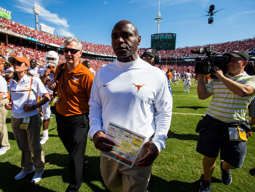 Texas Longhorns head coach Charlie Strong walks on to the field after losing the 2016 AT&T Red River Showdown 45-40 to the Oklahoma Sooners on Saturday, October 8, 2016 at the Cotton Bowl at Fair Park in Dallas. (Ashley Landis/The Dallas Morning News)