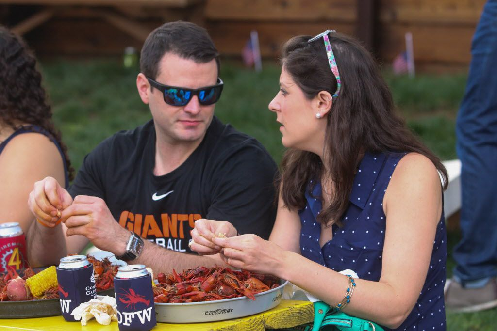 Friends enjoying the mudbugs at the Boil for the Brave crawfish boil benefitting Veterans Rehabilitation program was held at The Rustic in Uptown on April 18, 2015