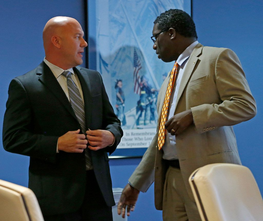 Brian Hass (left),  DallasFire-Rescue Dept., talks with City Council member Erik Wilson during a break at the Board of Trustees meeting of Dallas Police and Fire Pension System in Dallas, Thursday, Oct. 13, 2016. (Jae S. Lee/The Dallas Morning News)