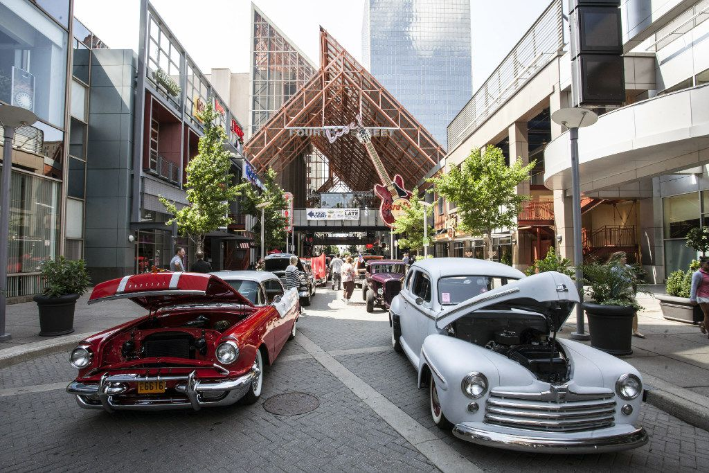 Vintage street hot rods draw interest from the lunchtime crowd at Fourth Street Live! in Louisville, Ky. The entertainment district was developed by the same company that Arlington has hired to build its own district.