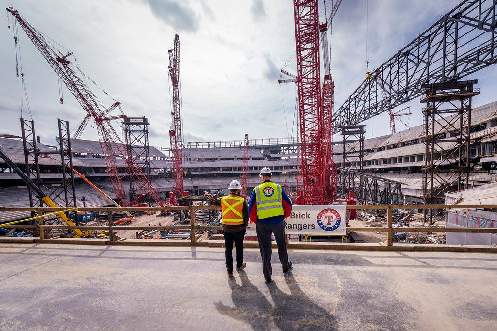 Rob Matwick, executive vice president of ballpark operations for the Texas Rangers (right) and Jim Cuddihee of  Manhattan Construction look over construction progress at Globe Life Field on Thursday, March 7, 2019, in Arlington. (Smiley N. Pool/The Dallas Morning News)
