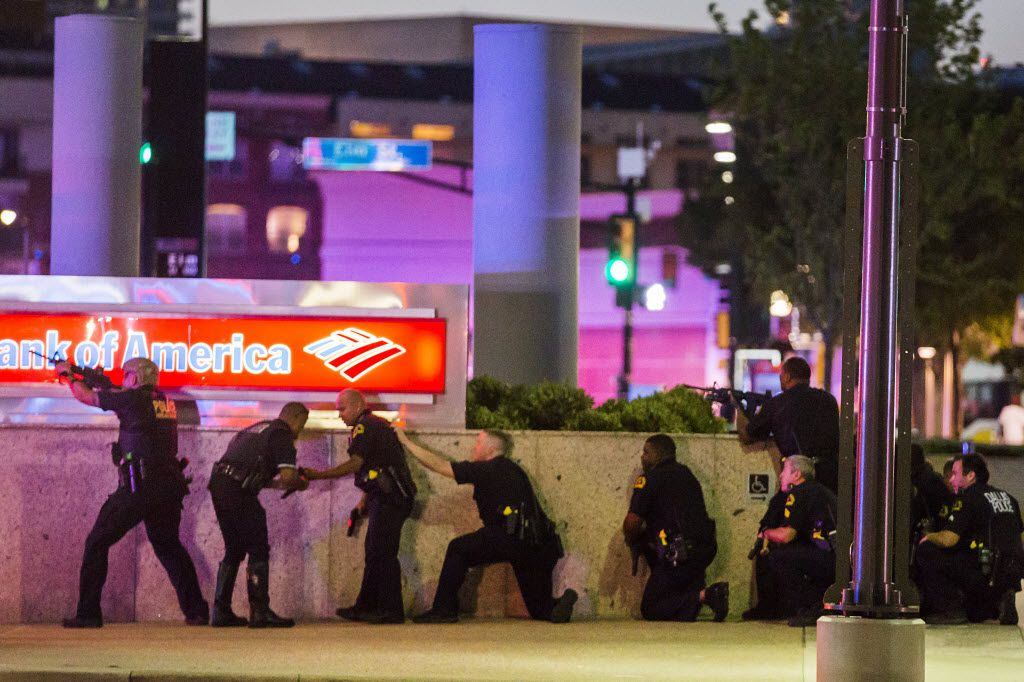 Dallas Police respond after shots were fired at a Black Lives Matter rally in downtown Dallas on Thursday, July 7, 2016. Dallas protestors rallied in the aftermath of the killing of Alton Sterling by police officers in Baton Rouge, La. and Philando Castile, who was killed by police less than 48 hours later in Minnesota. (Smiley N. Pool/The Dallas Morning News) -- MANDATORY CREDIT, NO SALES, MAGS OUT, TV OUT, INTERNET USE BY AP MEMBERS ONLY