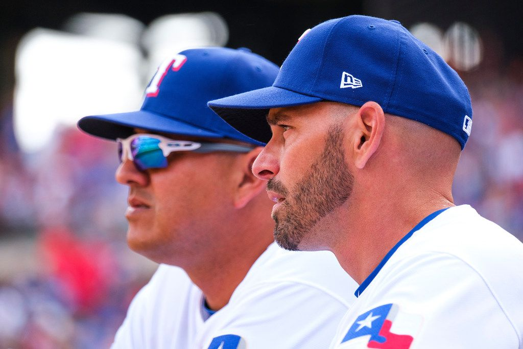 Texas Rangers manager Chris Woodward (right) and pitching coach Julio Rangel watch from the dugout during the sixth inning against the Chicago Cubs at Globe Life Park on Thursday, March 28, 2019, in Arlington. (Smiley N. Pool/The Dallas Morning News)