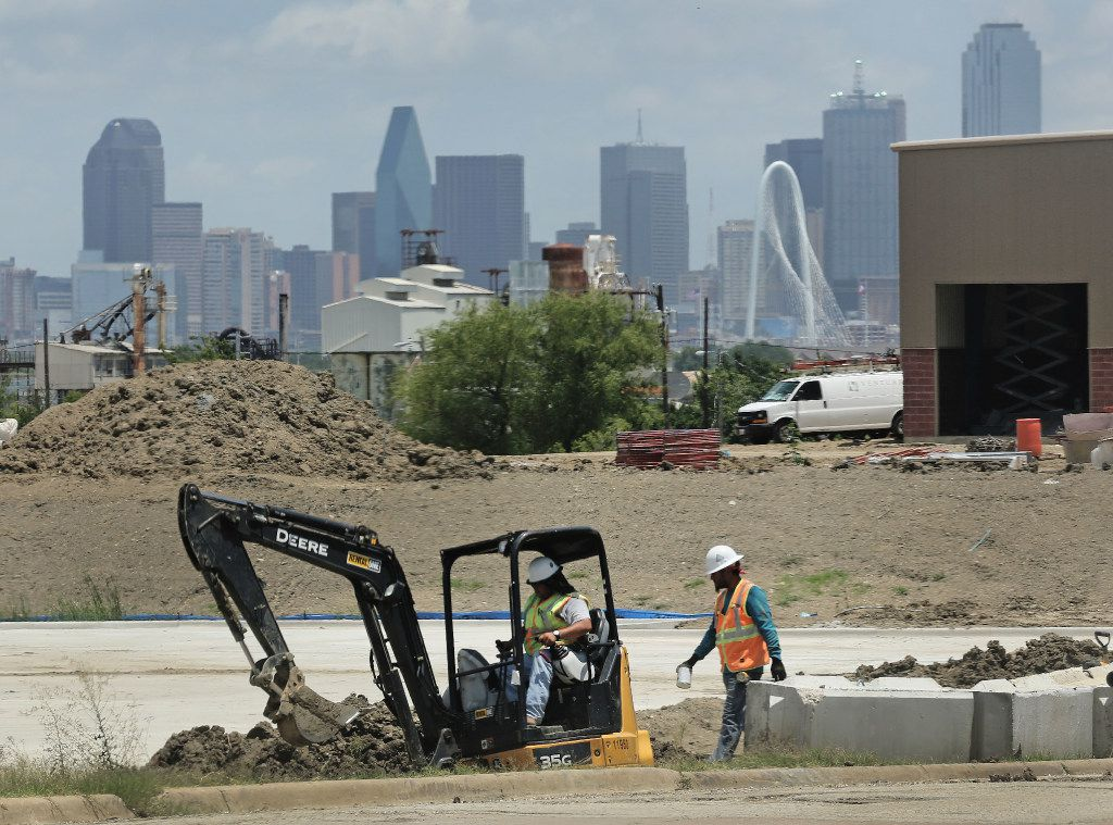 Downtown Dallas looms in the background of a construction project near Hampton Road in West Dallas.