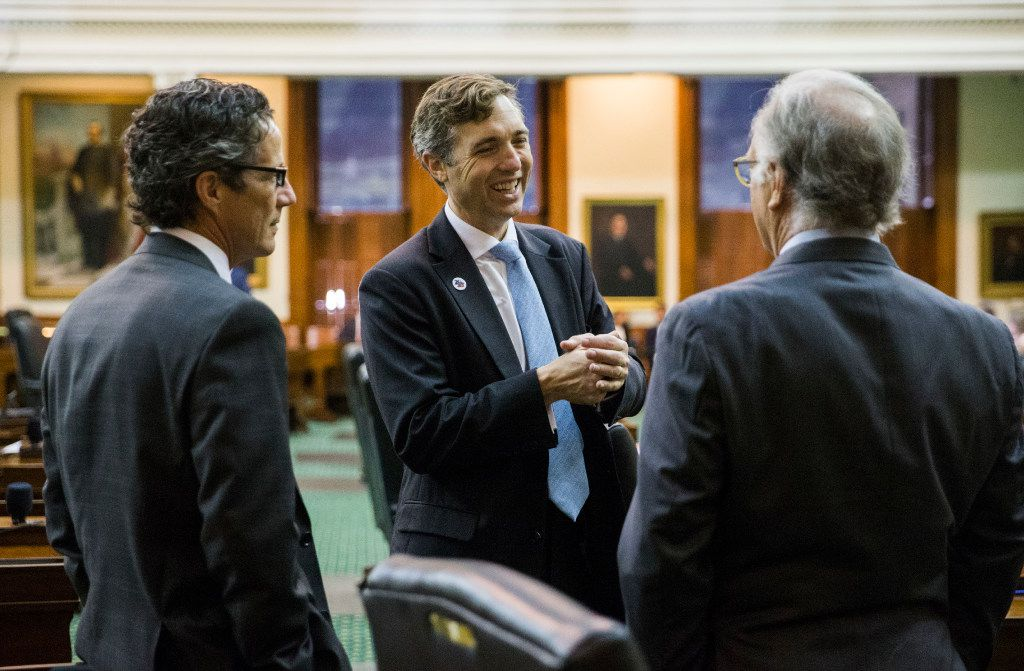 Senators Kelly Hancock, left, Van Taylor, center, and Kirk Watson, right, chat before the senate reconvenes at 12:01 a.m. for a third reading of the Sunset Bill during the third day of a special legislative session on Thursday, July 20, 2017 at the Texas state capitol in Austin, Texas.