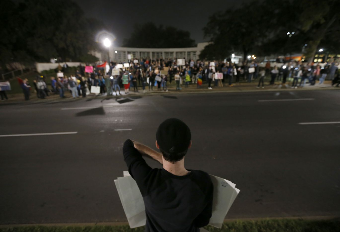 Trump supporter Patrick Connery stands across Elm Street as protesters against President-elect Donald Trump gather at Dealey Plaza in downtown Dallas, Thursday, Nov. 10, 2016.