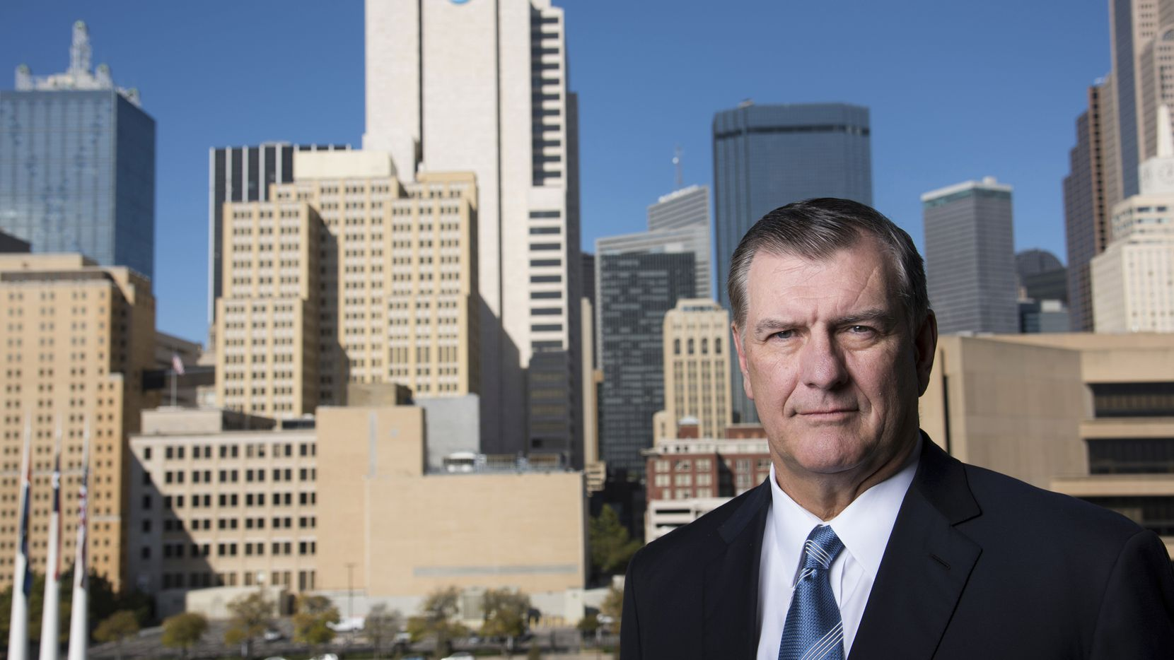 Mike Rawlings, the mayor of Dallas, stood in front of the city landscape last month. The city's pension fund for police and firefighters is near collapse and is seeking an immense bailout, a request that threatens to push the city into bankruptcy.
