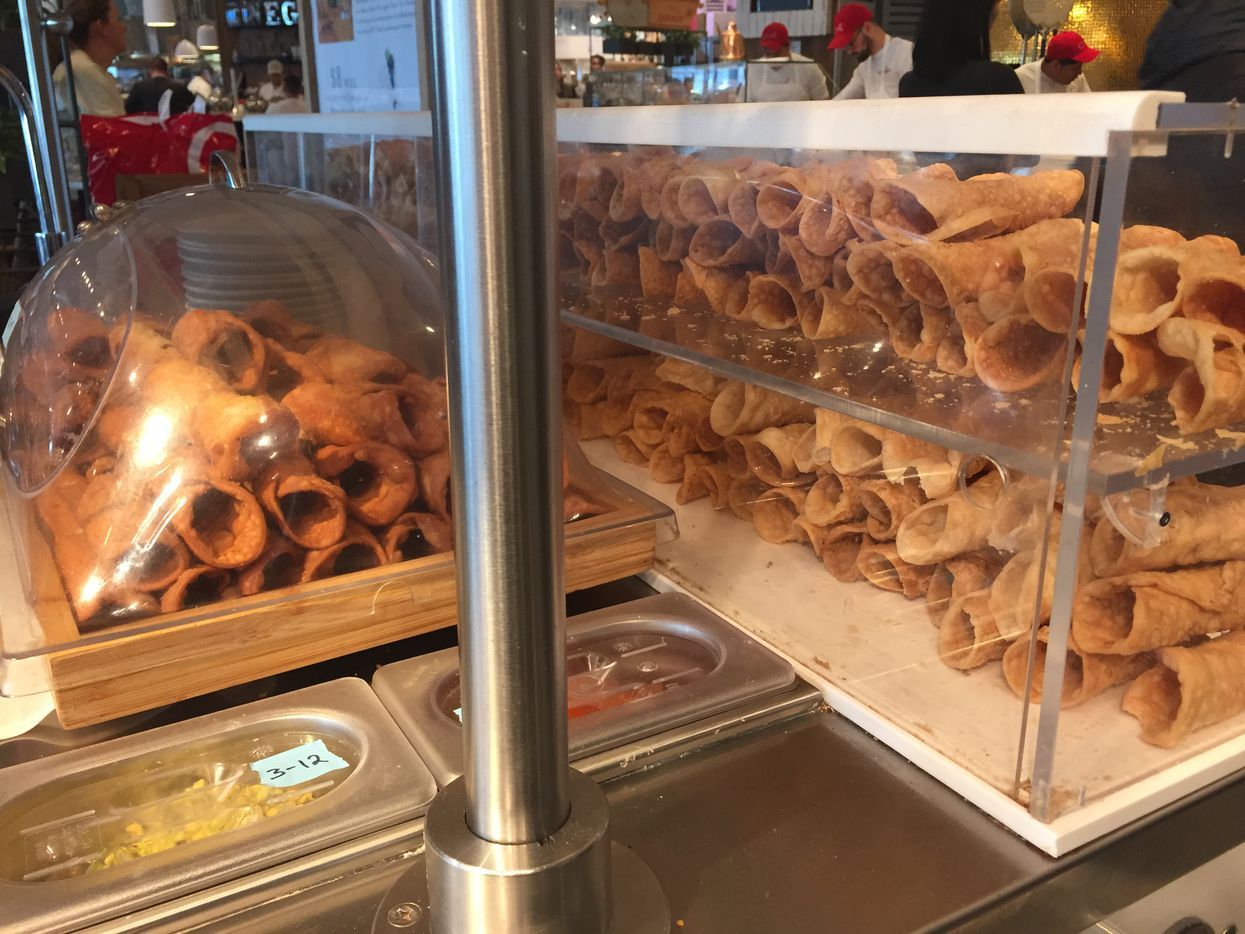 Cannoli pastries are filled once they're ready to be purchased. Photographed at Eataly in downtown Manhattan at the Westfield World Trade Center mall.