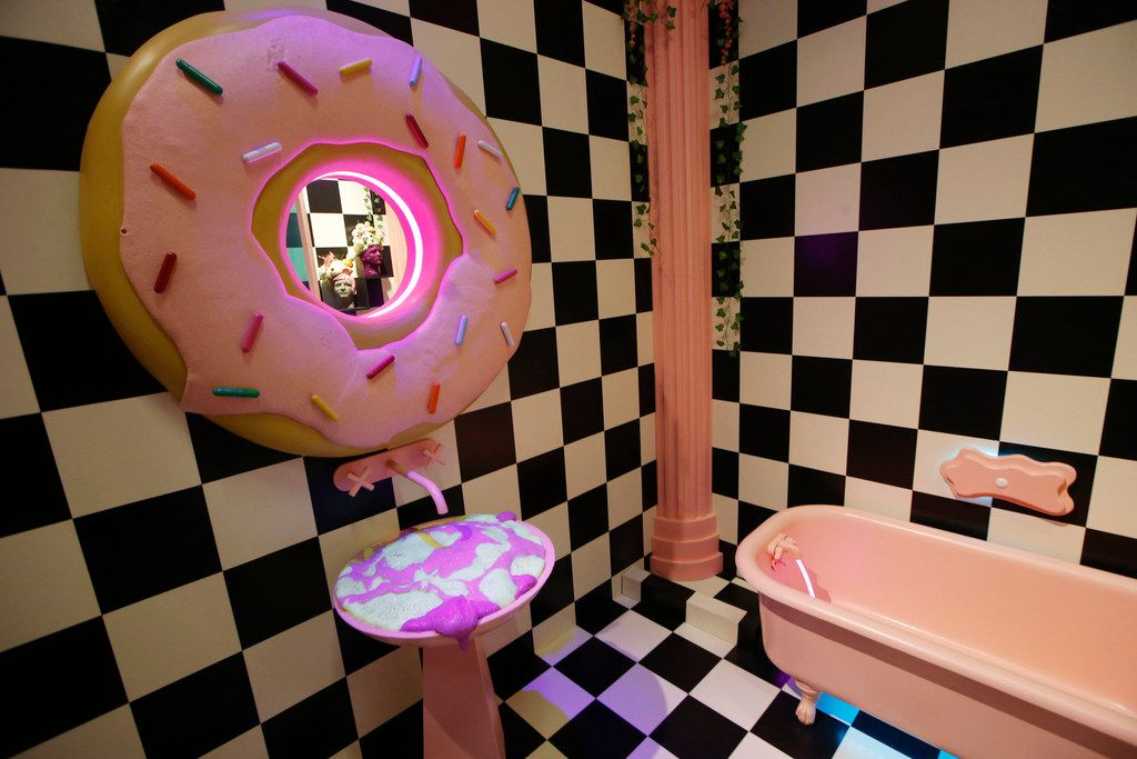 The doughnut bathroom at the Sweet Tooth Hotel in Dallas' Victory Park is lovingly called 'the Sprinkle Spa.' You can look — and touch — everything. But don't eat the doughnuts.