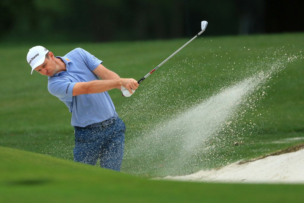 CHARLOTTE, NORTH CAROLINA - MAY 03: Justin Rose of England plays a shot from a bunker on the 11th hole during the second round of the 2019 Wells Fargo Championship at Quail Hollow Club on May 03, 2019 in Charlotte, North Carolina. (Photo by Sam Greenwood/Getty Images)