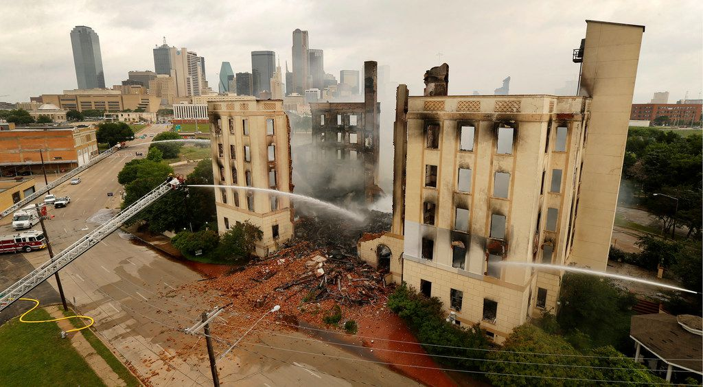 Dallas firefighters poured water on the destroyed historic Ambassador Hotel just south of downtown Dallas on May 28, 2019. More than 100 firefighters responded to the four-alarm fire. (Tom Fox/The Dallas Morning News)