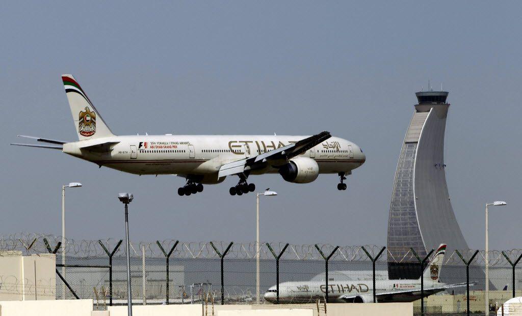 An Etihad Airways plane prepares to land at the Abu Dhabi airport in the United Arab Emirates. (AP File Photo/Kamran Jebreili)