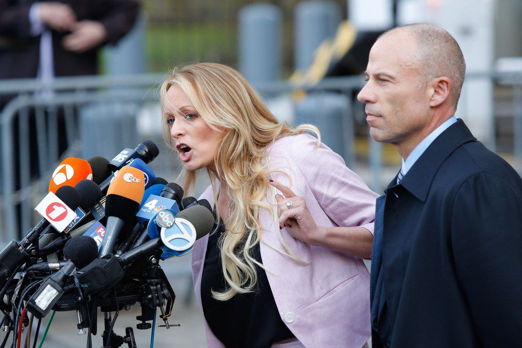 "In this file photo taken on April 16, 2018 adult-film actress Stephanie Clifford, also known as Stormy Daniels, speaks at U.S.  federal court with her lawyer, Michael Avenatti, in Lower Manhattan, N.Y. Daniels, locked in a court battle with President Donald Trump over their alleged affair, was arrested on July 11, 2018 while performing at a strip club in what her lawyer described as a ""politically motivated"" setup."