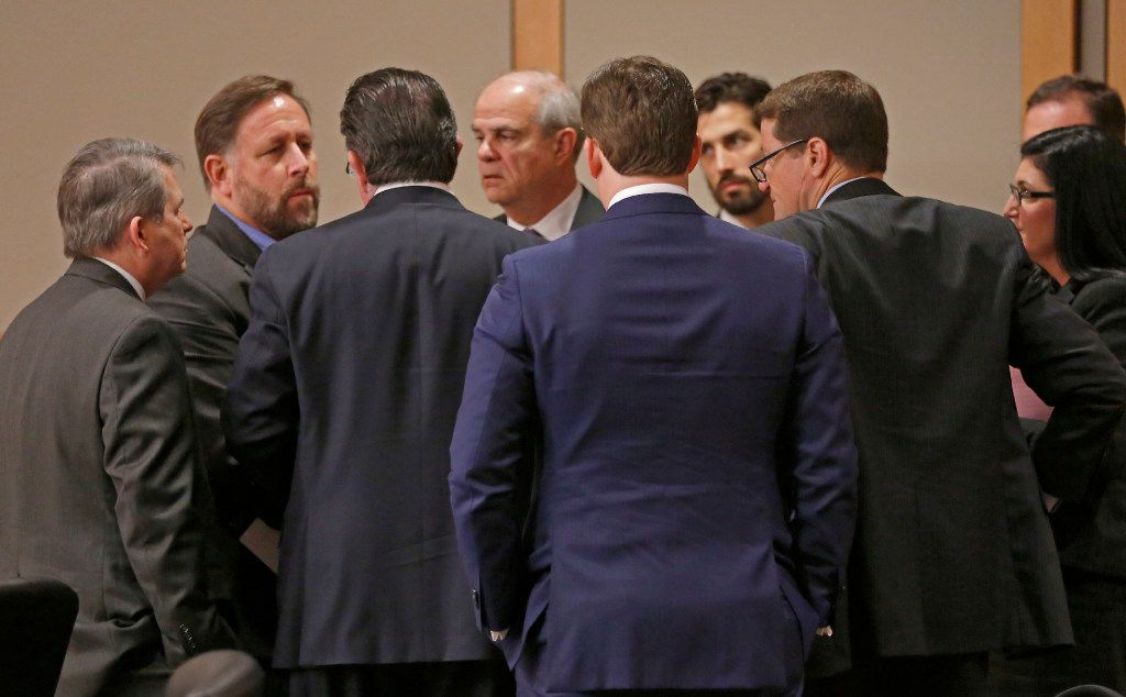A defense team for Texas Attorney General Ken Paxton gathers during a break at Collin County Courthouse in McKinney, Texas, Thursday, Feb. 16, 2017. (Jae S. Lee/The Dallas Morning News)