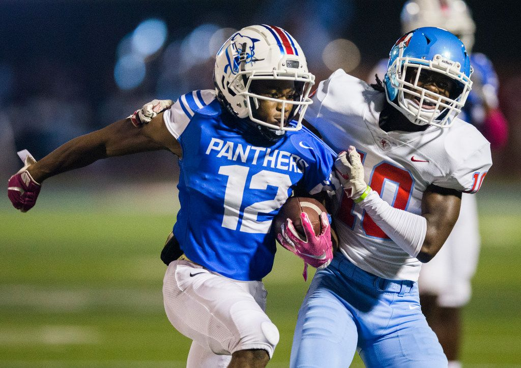 Duncanville running back Suavevion Persley (12) is pushed out of bounds by Skyline defensive back Milton Roundtree (10) during the second quarter of a high school football game between Skyline and Duncanville on Friday, October 4, 2019 at Panther Stadium in Duncanville. (Ashley Landis/The Dallas Morning News)