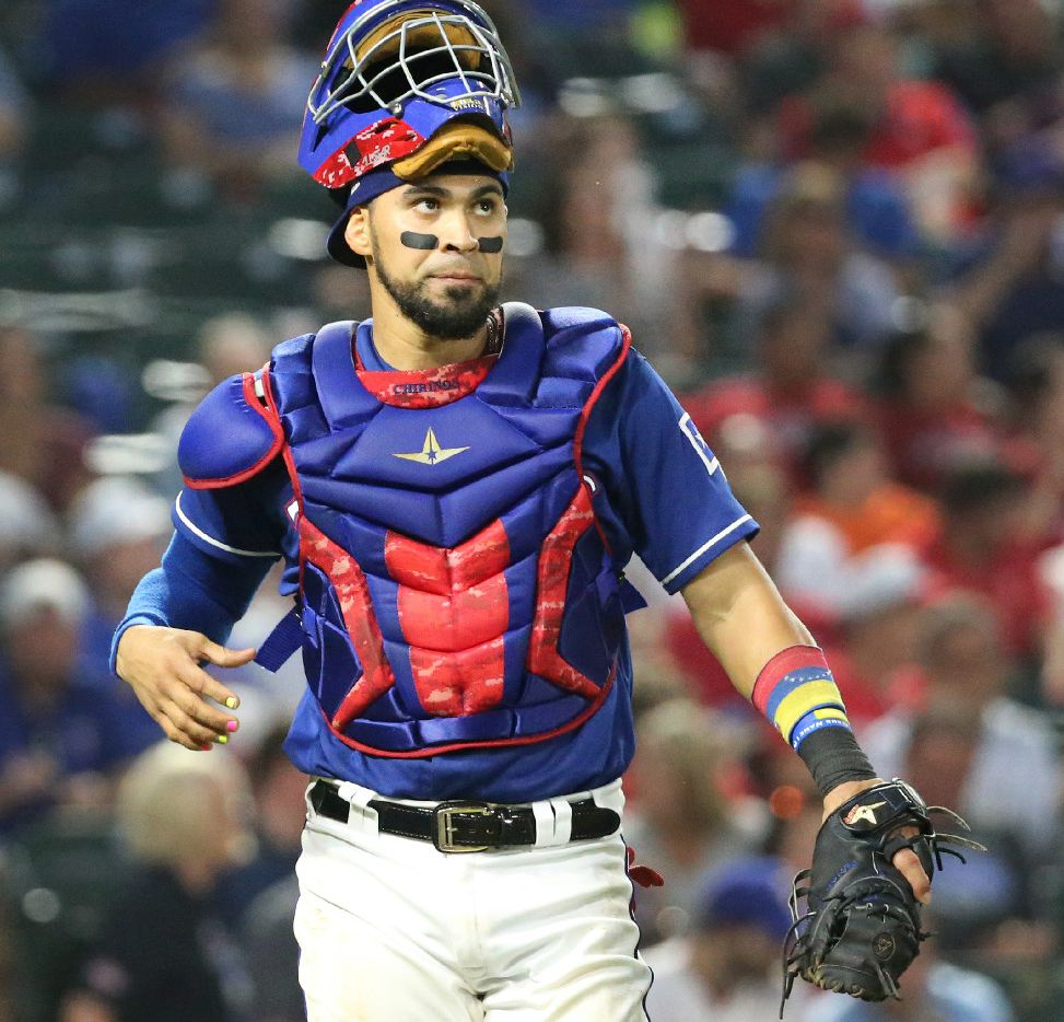 Texas Rangers catcher Robinson Chirinos (61) is pictured during the Seattle Mariners vs. the Texas Rangers major league baseball game at Globe Life Park in Arlington, Texas on Wednesday, August 2, 2017. (Louis DeLuca/The Dallas Morning News)