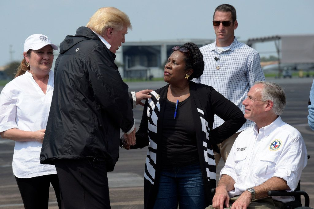 President Donald Trump talks with Rep. Sheila Jackson Lee, D-Texas, and Texas Gov. Greg Abbott before boarding Air Force One at Ellington Field after meeting people affected by Hurricane Harvey during a visit to Houston on Sept. 2.