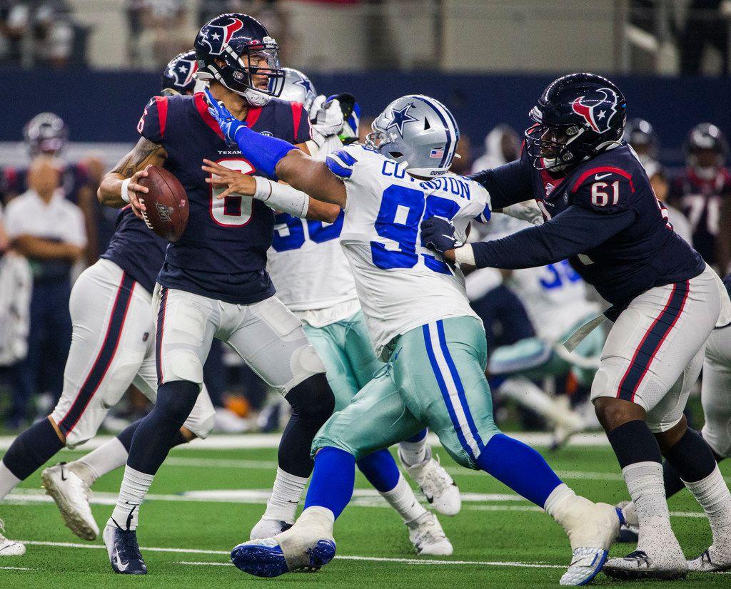 Dallas Cowboys defensive end Christian Covington (95) sacks Houston Texans quarterback Jordan Ta'amu-Perifanos (6) during the third quarter of an NFL game between the Dallas Cowboys and the Houston Texans on Saturday, August 24, 2019 at AT&T Stadium in Arlington. (Ashley Landis/The Dallas Morning News)