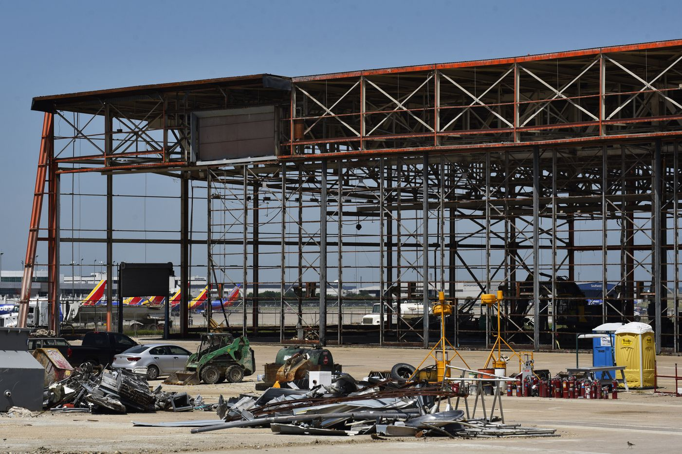 The old Braniff hangars at Dallas Love Field are being renovated just across the runway from the passenger terminal.