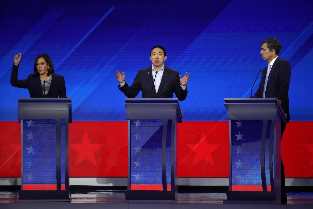 Democratic presidential candidates Sen. Kamala Harris, former tech executive Andrew Yang and former Texas congressman Beto O'Rourke interact onstage during the Democratic presidential debate at Texas Southern University on Sept. 12, 2019 in Houston.