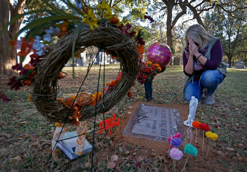Angela Norris prays while she visits the grave of her daughter, Taylor Gruwell, at Greenwood Memorial Park in Fort Worth.