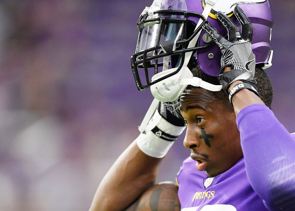 MINNEAPOLIS, MN - AUGUST 24: George Iloka #28 of the Minnesota Vikings puts on his helmet for warm ups before the preseason game against the Seattle Seahawks on August 24, 2018 at US Bank Stadium in Minneapolis, Minnesota. (Photo by Hannah Foslien/Getty Images) ORG XMIT: 775179931
