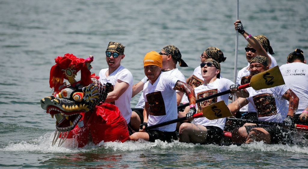 A boat rides low in the water during the 10th Annual Dragon Boat, Kite and Lantern Festival at Carolyn Lake in Las Colinas in 2017.15