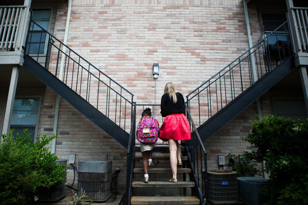 A CPS worker in Houston talks with an at-risk child. (File Photo/Houston Chronicle)