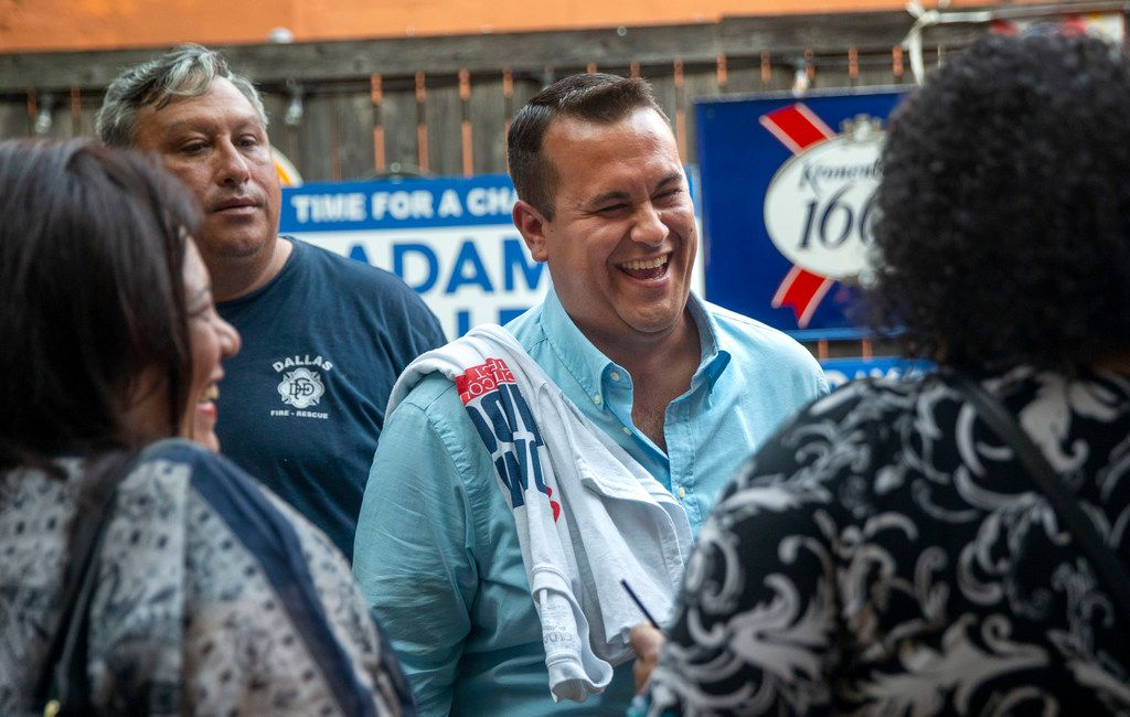Adam Bazaldua defeated former city council member Tiffinni Young in the South Dallas-anchored District 7 runoff earlier this month. Here he talked with supporters at his election-night watch party at Eight Bells Alehouse in Dallas on June 8.