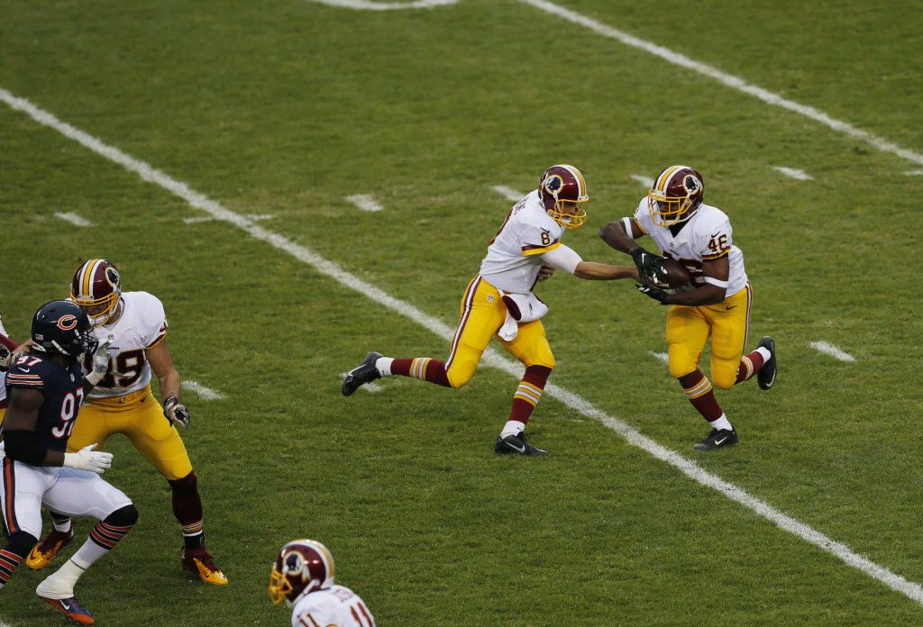 Washington Redskins quarterback Kirk Cousins (8) hands off to running back Alfred Morris (46) during the first half of an NFL football game against the Chicago Bears, Sunday, Dec. 13, 2015, in Chicago. (AP Photo/Kiichiro Sato)