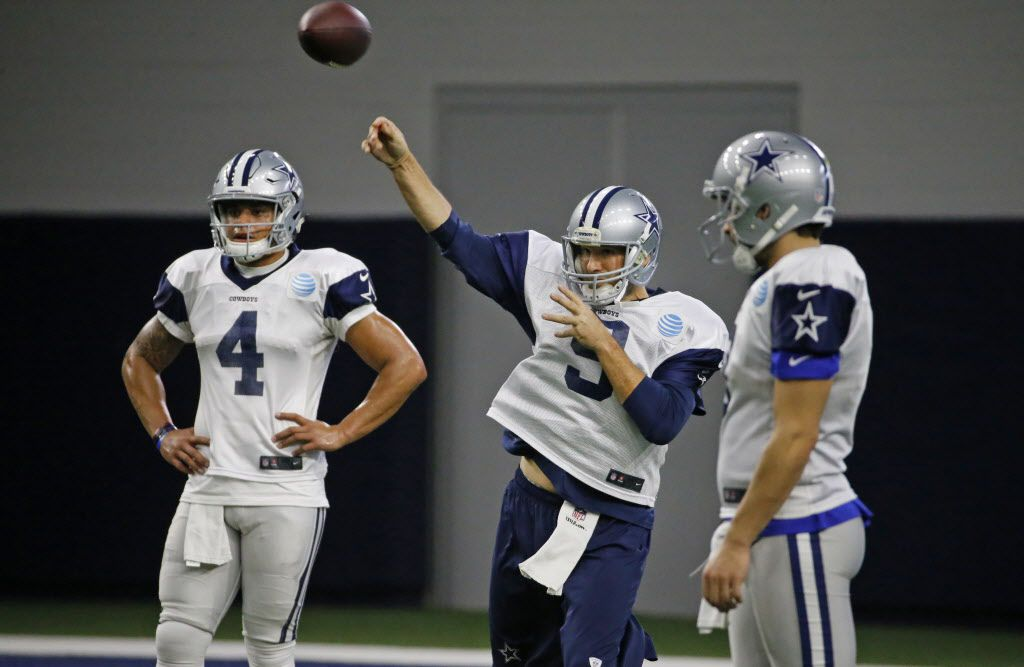 Dallas Cowboys quarterback Tony Romo (9) throws a pass as quarterback Dak Prescott (4) looks on during practice at the Star in Frisco, Texas, photographed on Wednesday, January 11, 2017. (Louis DeLuca/The Dallas Morning News)