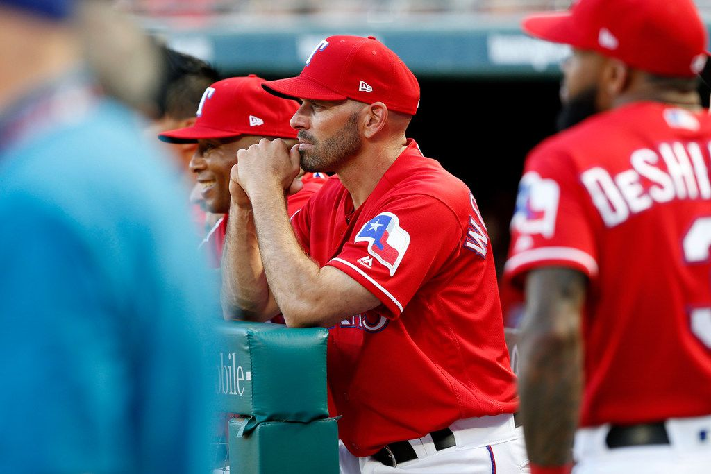 Texas Rangers Manager Chris Woodward looks on during a ceremony where former player Adrian Beltre's Texas Rangers jersey was retired before the second baseball game of a doubleheader against the Oakland Athletics in Arlington, Texas, Saturday June 8, 2019. (AP Photo/Roger Steinman)