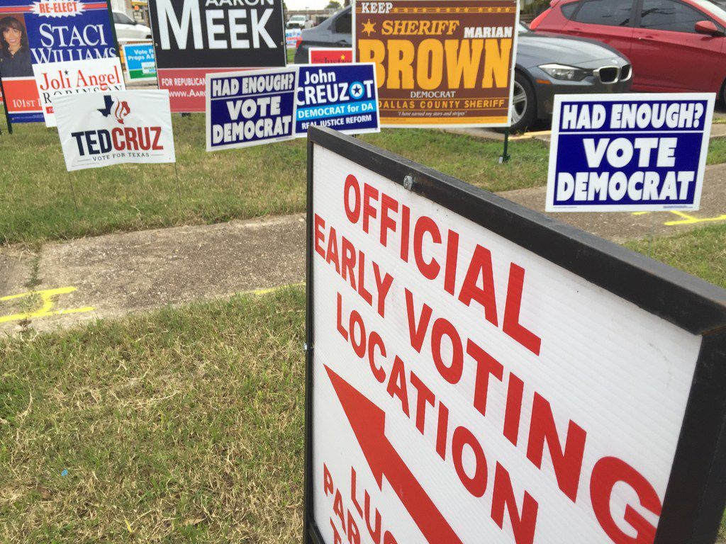 Candidates' signs stand near the Dallas County Government Center at the corner of Beckley Avenue and Twelfth Street.